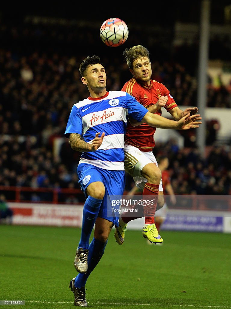 Jamie Ward of Nottingham Forest tackles <a gi-track='captionPersonalityLinkClicked' href=/galleries/search?phrase=Jamie+Mackie&family=editorial&specificpeople=5545546 ng-click='$event.stopPropagation()'>Jamie Mackie</a> of Queens Park Rangers during The Emirates FA Cup Third Round match between Nottingham Forest and Queens Park Rangers at City Ground on January 9, 2016 in Nottingham, England.