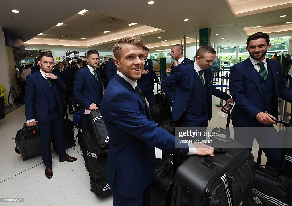 Jamie Ward smiles as he makes his way to the check-in desk before Northern Ireland's training camp departure at George Best Belfast City Airport on May 30, 2016 in Belfast, Northern Ireland. Northern Ireland have qualified for the Euro 2016 football championship finals in France, the first time the province has qualified for an international football tournament final since 1986.