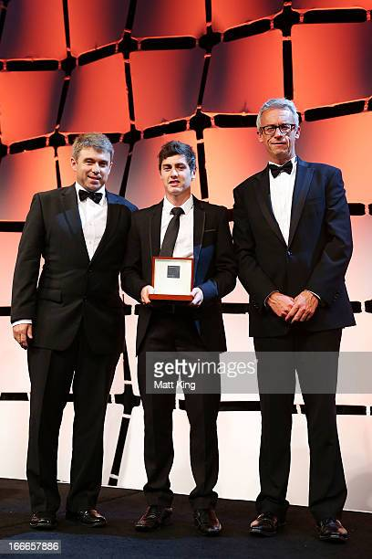 Jamie Warren and FFA CEO David Gallop present Marco Rojas of the Victory with the Johnny Warren Medal as the Hyundai ALeague Player of the Year...