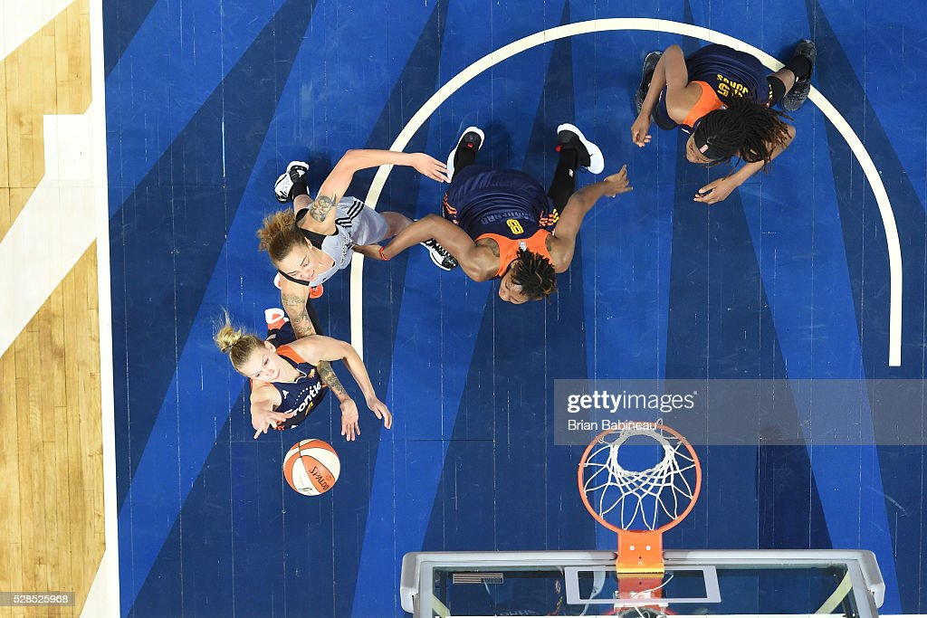 Jamie Weisner #4 of the Connecticut Sun goes up for a rebound against the San Antonio Stars in a WNBA preseason game on May 5, 2016 at the Mohegan Sun Arena in Uncasville, Connecticut.