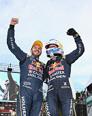 Jamie Whincup and Paul Dumberell drivers for the Red Bull Racing Australia Holden celebrate after winning race 32 for the Gold Coast 600 which is...