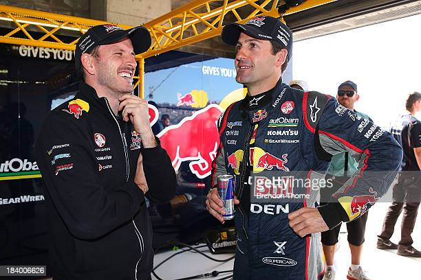 Jamie Whincup and Paul Dumbrell drivers of the Red Bull Racing Australia Holden celebrate qualifying on pole position following qualifying for the...