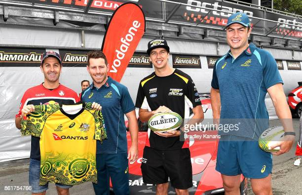 Jamie Whincup Bernard Foley Chaz Mostert and Rob Simmons pose for a photo during an Australian Wallabies media opportunity in Pit Lane ahead of the...