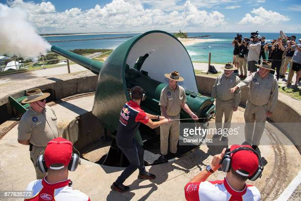 Jamie Whincup driver of the Red Bull Holden Racing Team Holden Commodore VF fires a cannon at Fort Scratchley ahead of the Newcastle 500 which is...