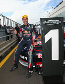 Jamie Whincup driver of the Red Bull Racing Australia Holden celebrates after winning race 34 of the V8 Supercars Championship Series at Phillip...