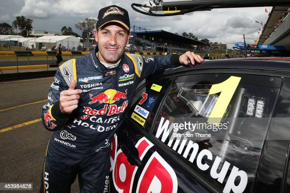 Jamie Whincup driver of the Red Bull Racing Australia Holden celebrates after claiming pole position for Race 1 during qualifying which is round nine...