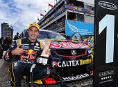 Jamie Whincup driver of the Red Bull Racing Australia Holden celebrates after winning race 36 for the Sydney 500 which is part of the V8 Supercar...
