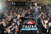 Jamie Whincup driver of the Red Bull Racing Australia Holden celebrates after he is presented with the 2014 V8 Supercar Championship trophy after...