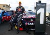 Jamie Whincup driver of the Red Bull Racing Australia Holden celebrates after winning race five of the Tasmania 400 which is round two of the V8...