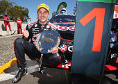 Jamie Whincup driver of the Red Bull Racing Australia Holden celebrates after winning race 34 for the Sydney 500 which is part of the V8 Supercar...