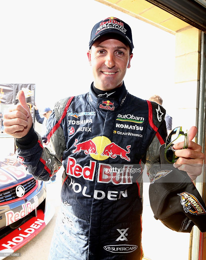 Jamie Whincup driver of the #1 Red Bull Racing Australia Holden gives the thumbs up after taking pole position after the qualifying session for round two of the V8 Supercar Championship Series at Symmons Plains Raceway on April 6, 2013 in Launceston, Australia.