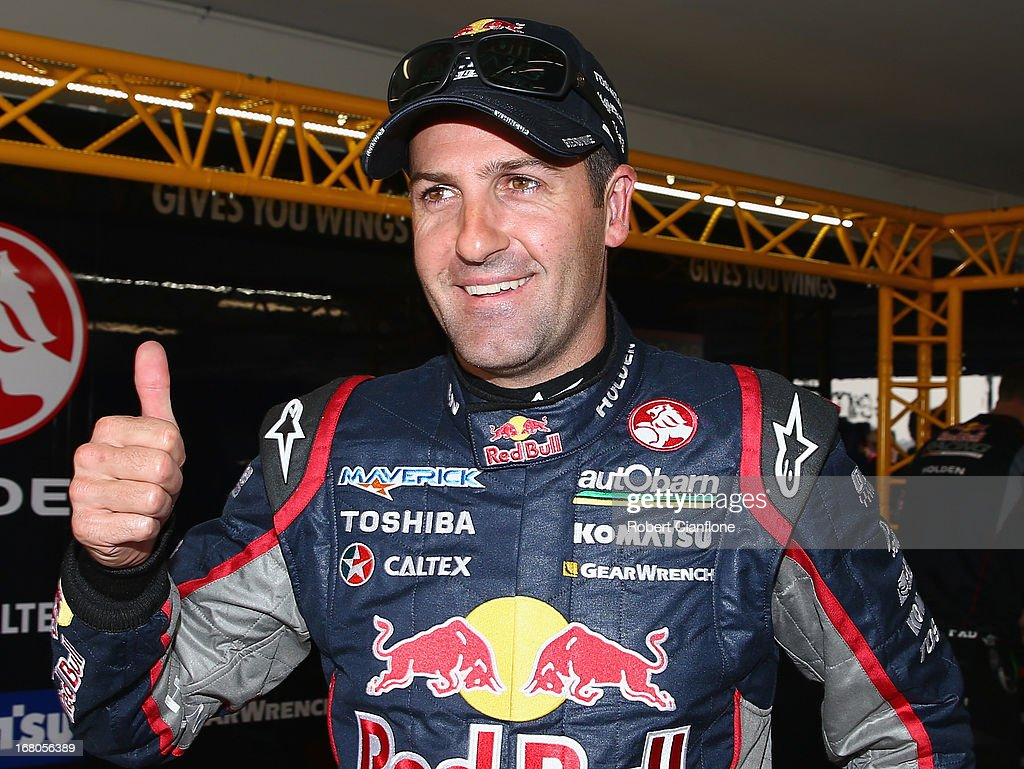 Jamie Whincup driver of the #1 Red Bull Racing Australia Holden gives the thumbs up after taking pole position for race 12 for the Perth 360, which is round four of the V8 Supercar Championship Series at Barbagallo Raceway on May 5, 2013 in Perth, Australia.
