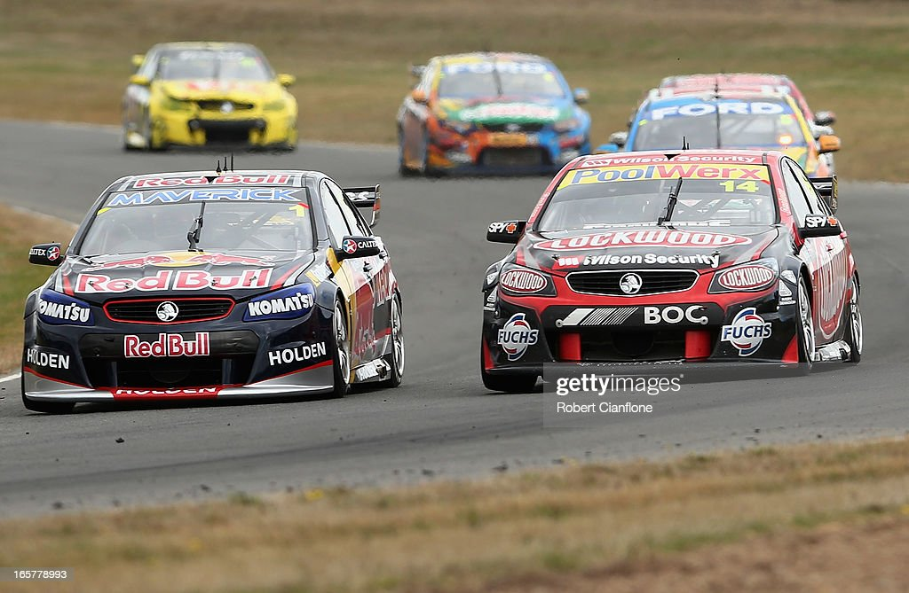 <a gi-track='captionPersonalityLinkClicked' href=/galleries/search?phrase=Jamie+Whincup&family=editorial&specificpeople=678654 ng-click='$event.stopPropagation()'>Jamie Whincup</a> driver of the #1 Red Bull Racing Australia Holden is overtaken by <a gi-track='captionPersonalityLinkClicked' href=/galleries/search?phrase=Fabian+Coulthard&family=editorial&specificpeople=678657 ng-click='$event.stopPropagation()'>Fabian Coulthard</a> driving the #14 Lockwood Racing Holden during race three for round two of the V8 Supercar Championship Series at Symmons Plains Raceway on April 6, 2013 in Launceston, Australia.