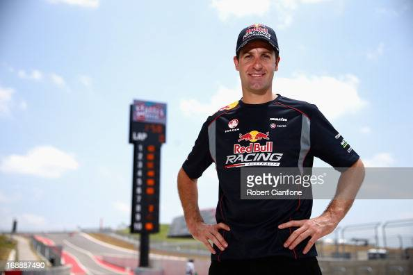 Jamie Whincup driver of the Red Bull Racing Australia Holden poses in pit lane during previews ahead of the Austin 400 which is round five of the V8...