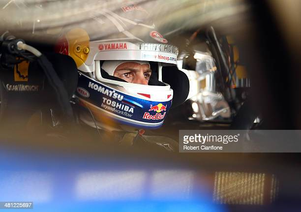 Jamie Whincup driver of the Red Bull Racing Australia Holden sits in his car prior to qualifying for the Tasmania 400 which is round two of the V8...