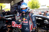 Jamie Whincup driver of the Red Bull Racing Australia Holden celebrates taking pole position in the Top Ten Shootout for the Sydney 500 which is race...