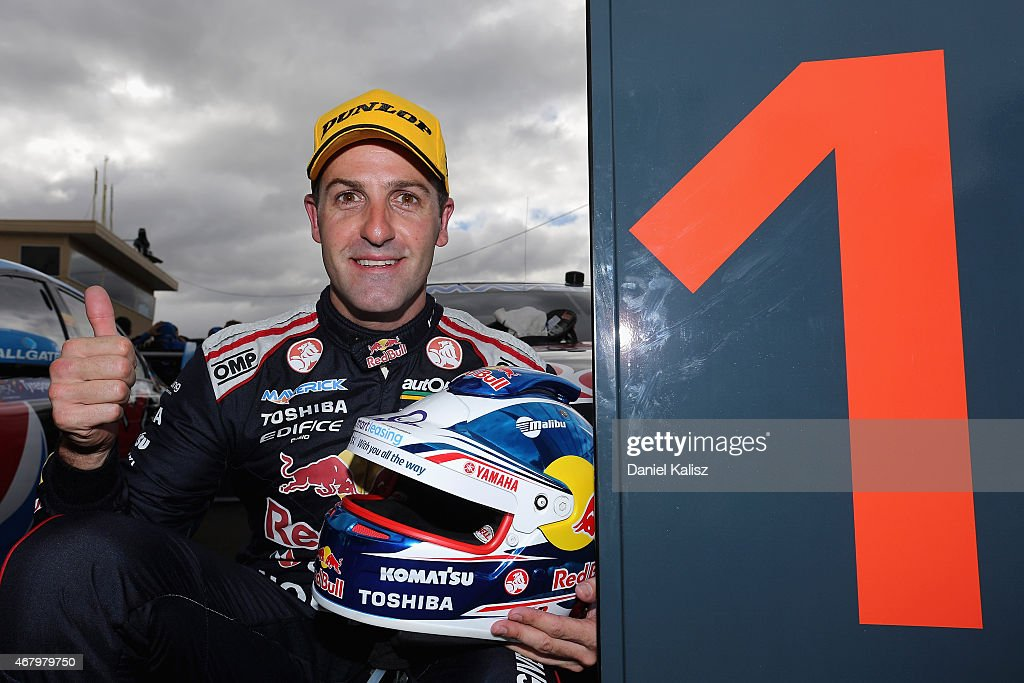 Jamie Whincup driver of the Red Bull Racing Australia Holden VF Commodore reacts after winning race 3 for the V8 Supercars Tasmania SuperSprint at...