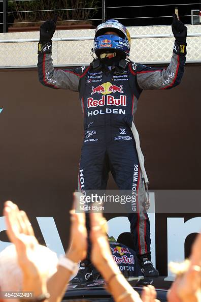 Jamie Whincup driver of the Red Bull Racing Australia Holden celebrates winning the championship after finishing third in the Sydney 500 which is...