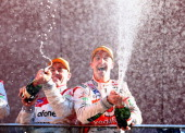 Jamie Whincup driver of the Team Vodafone Holden celebrates after he and Paul Dumbrell won the Bathurst 1000 which is round 11 of the V8 Supercars...