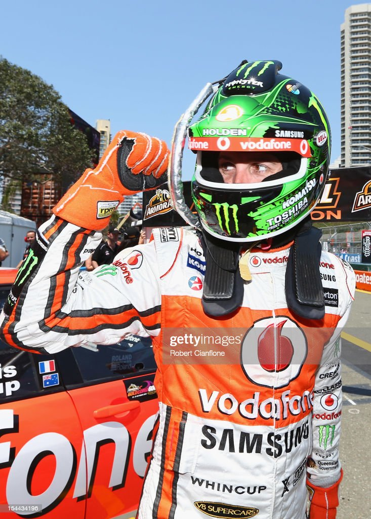 <a gi-track='captionPersonalityLinkClicked' href=/galleries/search?phrase=Jamie+Whincup&family=editorial&specificpeople=678654 ng-click='$event.stopPropagation()'>Jamie Whincup</a> driver of the #1 Team Vodafone Holden celebrates after he took pole position in the Top 10 Shootout for the Gold Coast 600, which is round 12 of the V8 Supercars Championship Series at the Gold Coast Street Circuit on October 20, 2012 on the Gold Coast, Australia.