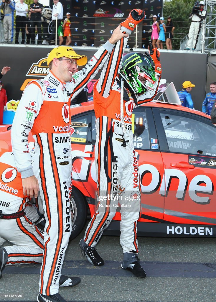 Jamie Whincup driver of the Team Vodafone Holden celebrates after he and codriver Sebastian Bourdais of France won race 22 for the Gold Coast 600...