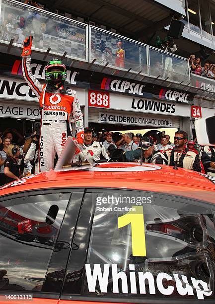 Jamie Whincup driver of the Team Vodafone Holden celebrates after winning race one for the Clipsal 500 which is round one of the V8 Supercar...