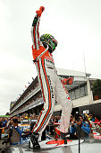 Jamie Whincup driver of the Team Vodafone Holden celebrates winning the 2012 Championship after the Sydney 500 which is round 15 of the V8 Supercars...