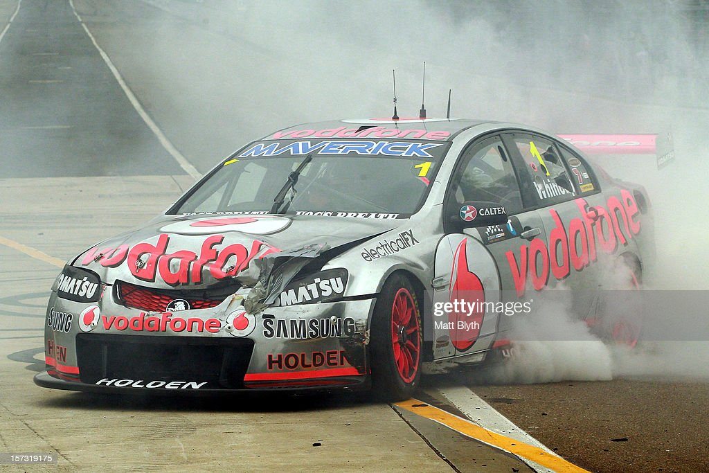 Jamie Whincup driver of the #1 Team Vodafone Holden celebrates winning the 2012 championship with a burnout after the Sydney 500, which is round 15 of the V8 Supercars Championship Series at Sydney Olympic Park Street Circuit on December 2, 2012 in Sydney, Australia.