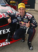 Jamie Whincup driver the Red Bull Racing Australia Holden celebrates after winning Race 32 for the Phillip Island SuperSprint which is part of the V8...