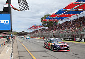 Jamie Whincup driver the Red Bull Racing Australia Holden crosses the line to win race one for the V8 Supercars Clipsal 500 at the Adelaide Street...