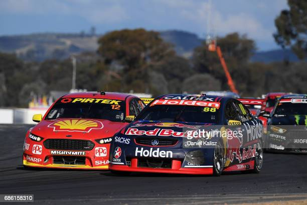 Jamie Whincup drives the Red Bull Holden Racing Team Holden Commodore VF leads Fabian Coulthard drives the Shell VPower Racing Team Ford Falcon FGX...