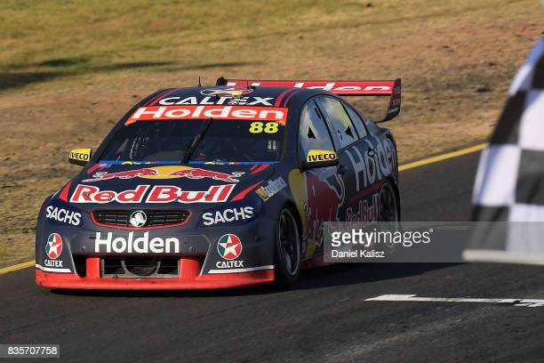 Jamie Whincup drives the Red Bull Holden Racing Team Holden Commodore VF takes the chequred flag to win race 18 for the Sydney SuperSprint which is...