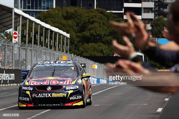 Jamie Whincup drives the Red Bull Racing Australia Holden celebrates after crossing the line to win race 36 for the Sydney 500 which is part of the...