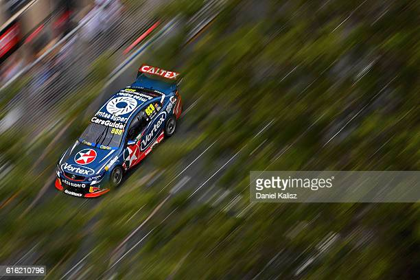 Jamie Whincup drives the Red Bull Racing Australia Holden Commodore VF during for race 22 of the Supercars Gold Coast 600 at Surfers Paradise Street...