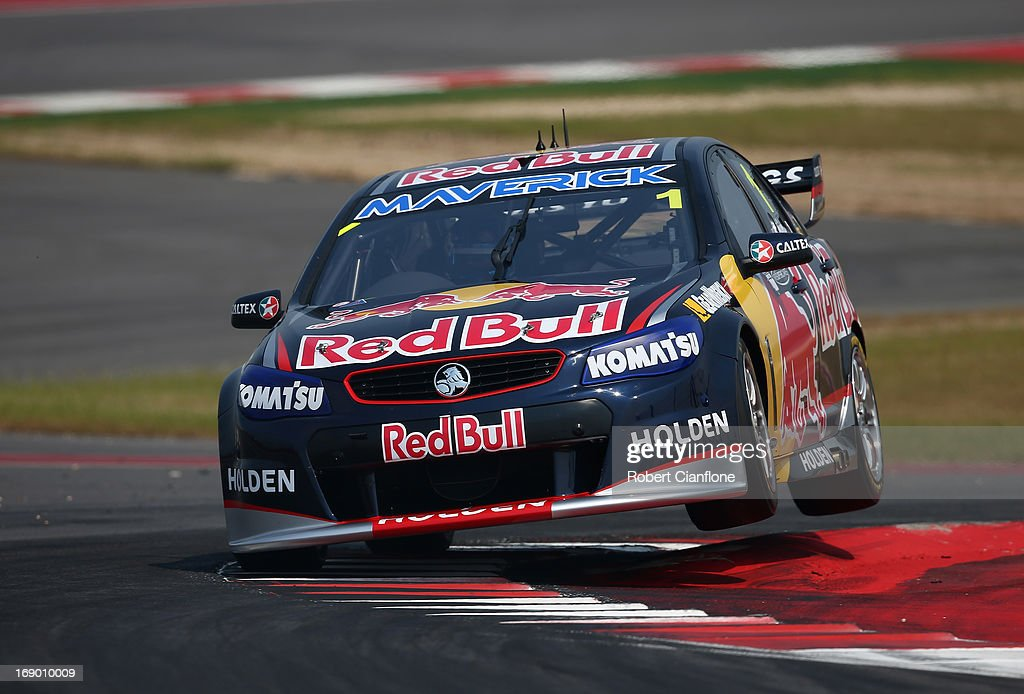 <a gi-track='captionPersonalityLinkClicked' href=/galleries/search?phrase=Jamie+Whincup&family=editorial&specificpeople=678654 ng-click='$event.stopPropagation()'>Jamie Whincup</a> drives the #1 Red Bull Racing Australia Holden during race 13 for the Austin 400, which is round five of the V8 Supercar Championship Series at Circuit of The Americas on May 18, 2013 in Austin, Texas.