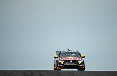 Jamie Whincup drives the Red Bull Racing Australia Holden during race 34 at the Phillip Island 400 which is part of the V8 Supercar Championship...