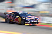 Jamie Whincup drives the Red Bull Racing Australia Holden during race one of the V8 Supercar Championship Series at the Adelaide Street Circuit on...