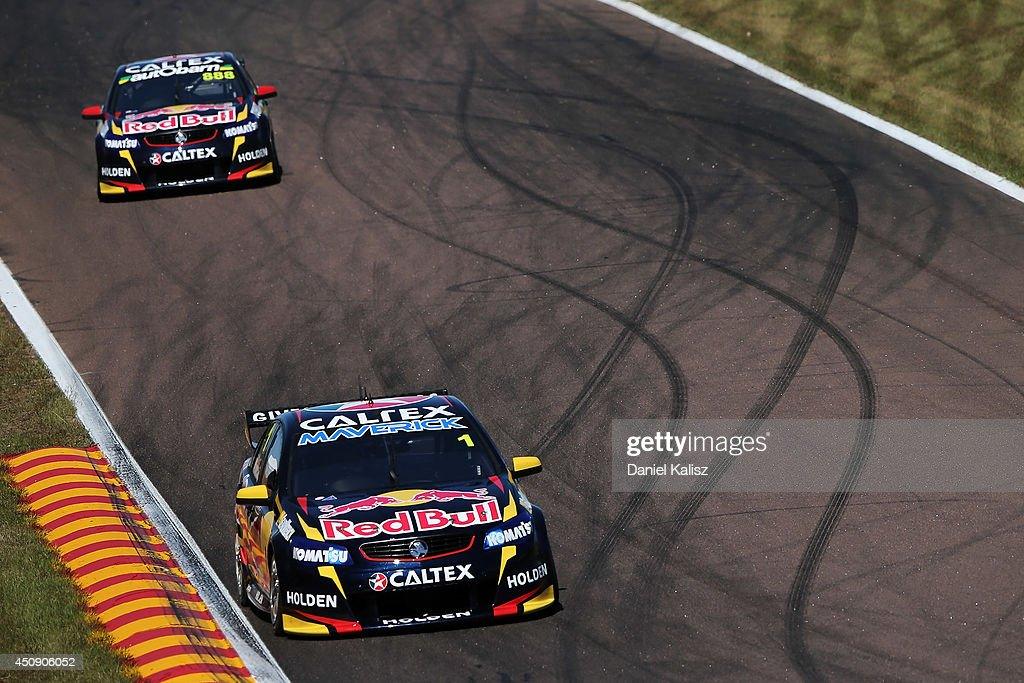 Jamie Whincup drives the #1 Red Bull Racing Australia Holden leads Craig Lowndes drives the #888 Red Bull Racing Australia Holden during practice for the Triple Crown Darwin, which is round six of the V8 Supercar Championship Series at Hidden Valley Raceway on June 20, 2014 in Darwin, Australia.