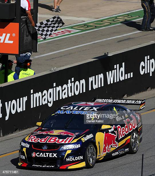 Jamie Whincup drives the Red Bull Racing Australia Holden to take the chequred flag to win Race 1 for the Clipsal 500 which is round one of the V8...