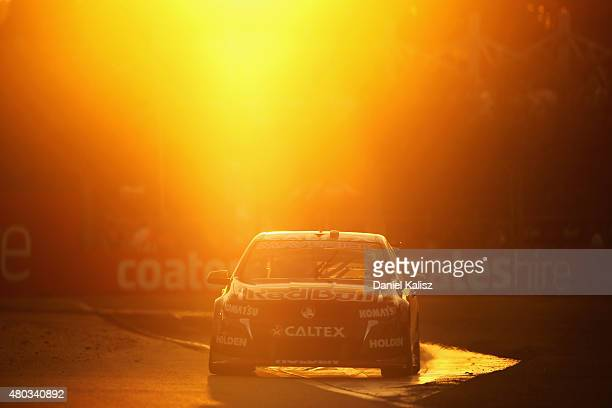 Jamie Whincup drives the Red Bull Racing Australia Holden VF Commodore during race 16 for the Townsville 400 which is round six of the V8 Supercar...