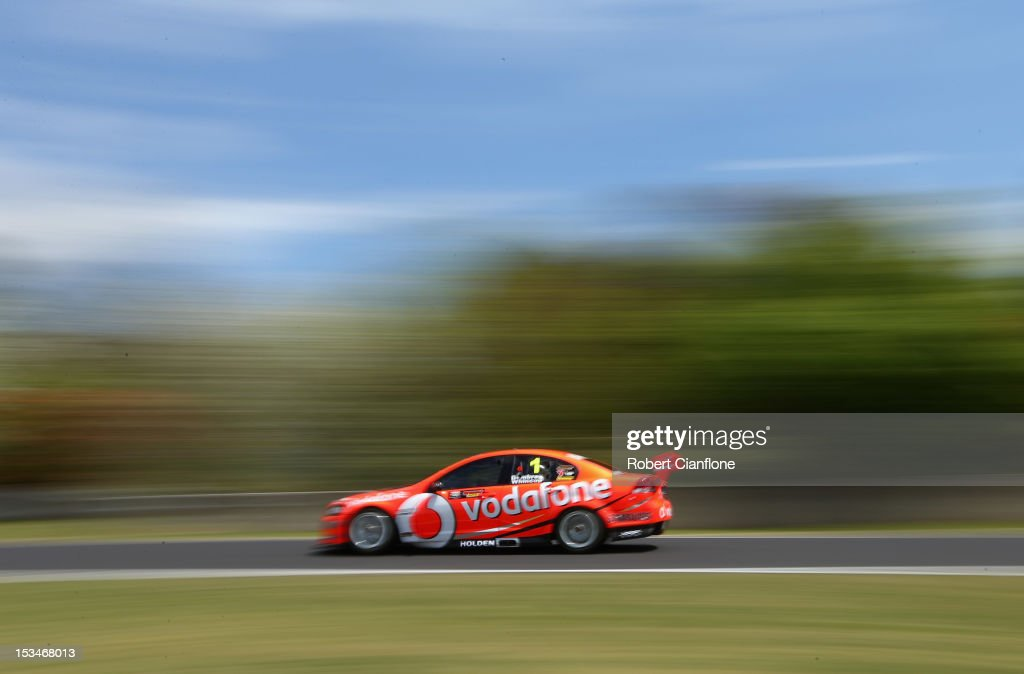 <a gi-track='captionPersonalityLinkClicked' href=/galleries/search?phrase=Jamie+Whincup&family=editorial&specificpeople=678654 ng-click='$event.stopPropagation()'>Jamie Whincup</a> drives the #1 Team Vodafone Holden during practice for the Bathurst 1000, which is round 11 of the V8 Supercars Championship Series at Mount Panorama on October 6, 2012 in Bathurst, Australia.