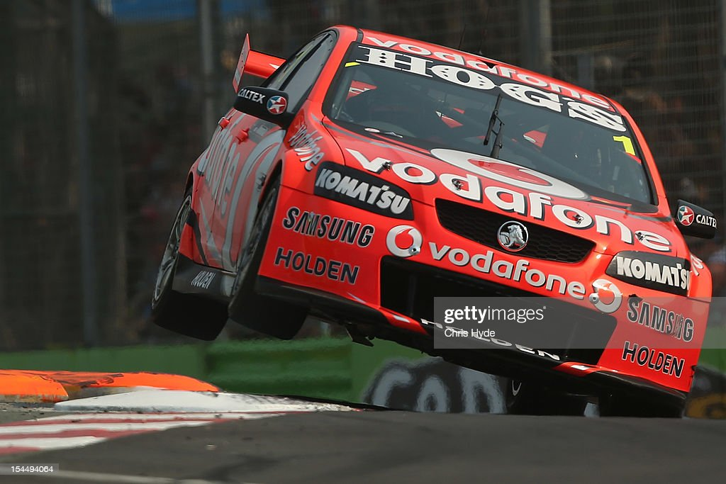 <a gi-track='captionPersonalityLinkClicked' href=/galleries/search?phrase=Jamie+Whincup&family=editorial&specificpeople=678654 ng-click='$event.stopPropagation()'>Jamie Whincup</a> drives the #1 Team Vodafone Holden during race 23 of the Gold Coast 600, which is round 12 of the V8 Supercars Championship Series at the Gold Coast Street Circuit on October 21, 2012 on the Gold Coast, Australia.