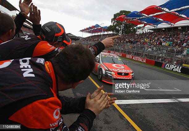 Jamie Whincup driving the Team Vodafone Holden is congratulated by his crew after winning race four of the Clipsal 500 which is round two of the V8...