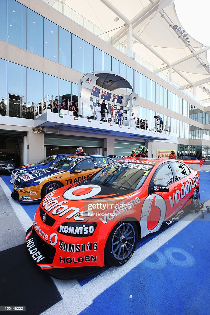 <a gi-track='captionPersonalityLinkClicked' href=/galleries/search?phrase=Jamie+Whincup&family=editorial&specificpeople=678654 ng-click='$event.stopPropagation()'>Jamie Whincup</a> lifts the trophy in celebration on the podium after driving the Team Vodafone Holden Commodore to victory during the V8 Supercars race 3 at the Yas Marina Circuit on November 4, 2012 in Abu Dhabi, United Arab Emirates.