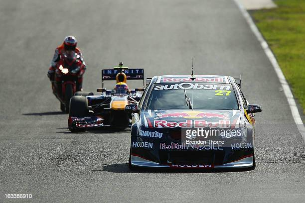 Jamie Whincup of Red Bull Racing Australia Holden Mark Webber of Australia and Infiniti Red Bull Racing and Casey Stoner of Red Bull Pirtek Holden...