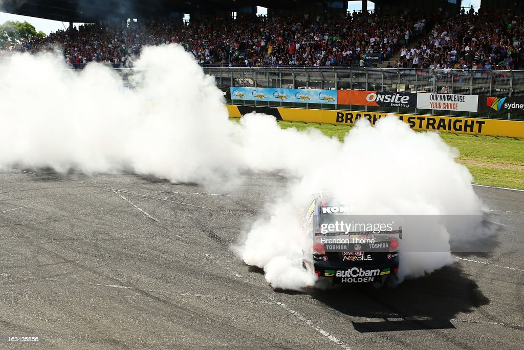 Jamie Whincup of Red Bull Racing Australia Holden performs donuts during the Top Gear Festival at Sydney Motorsport Park on March 10, 2013 in Sydney, Australia.