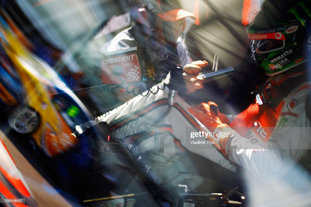 Jamie Whincup of Team Vodafone Holden Commodore prepares to drive during the V8 Supercars race 3 at the Yas Marina Circuit on November 4, 2012 in Abu Dhabi, United Arab Emirates.