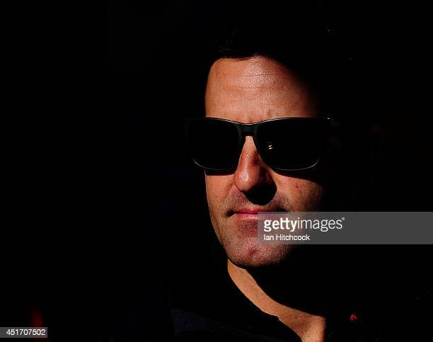 Jamie Whincup who drives the Red Bull Racing Australia Holden looks on during an autograph session before race 20 for the Townsville 500 which is...