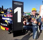 Jamie Whincup who drives the Red Bull Racing Holden celebrates after winning race 20 of the Townsville 500 which is round seven of the V8 Supercar...