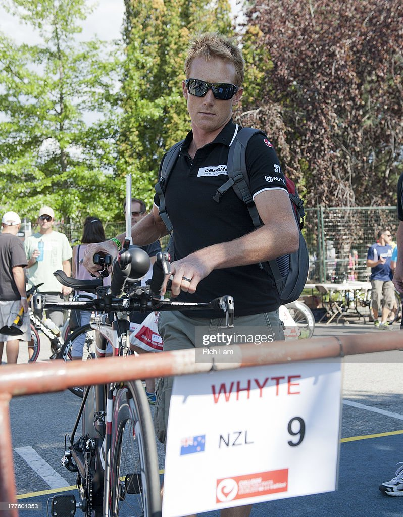 Jamie Whyte of New Zealand racks his bike during the Challenge Penticton Triathlon previews on August 24, 2013 in Penticton, British Columbia, Canada.